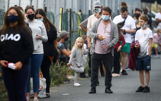 People queue at a test centre following an outbreak of the coronavirus disease (COVID-19) in Southend-on-sea, Britain Sept 16, 2020. REUTERS