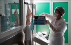 A nurse wearing a protective face mask works in the Intensive Care Unit (ICU) at the Robert Ballanger hospital in Aulnay-sous-Bois near Paris as the outbreak of the coronavirus disease (COVID-19) continues in France, Sept 15, 2020. REUTERS/FILE