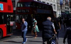 Pedestrians, some wearing protective face masks, walk along Oxford Street, amid the coronavirus disease (COVID-19) outbreak, in London, Britain, September 17, 2020. Reuters