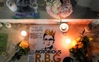 Candles are lit next to pictures of Associate Justice Ruth Bader Ginsburg as people mourn her death at the Supreme Court in Washington, Sept 19, 2020. REUTERS