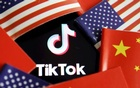 China and US flags are seen near a TikTok logo in this illustration picture taken July 16, 2020. REUTERS