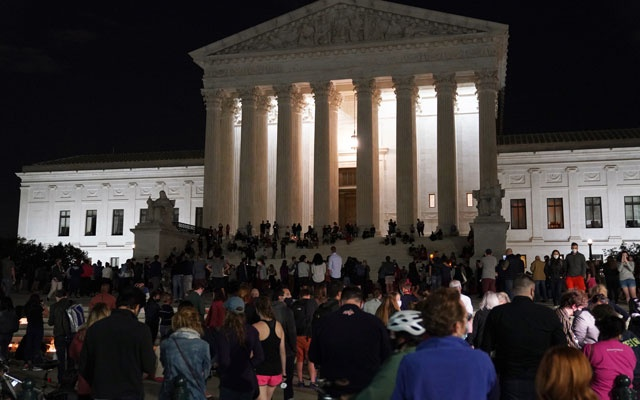 Mourners gather outside the Supreme Court building in Washington, following the announcement of Justice Ruth Bader Ginsburg's death, on Friday, Sept. 18, 2020. After Ginsburg's death, it was not clear that President Donald Trump's right-wing coalition would be more motivated by a confirmation fight than the alliance of liberals and moderates supportive of Joe Biden would be. (Anna Moneymaker/The New York Times)