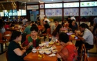People eat at a restaurant following the coronavirus disease (COVID-19) outbreak, in Chengdu, Sichuan province, China September 8, 2020. REUTERS