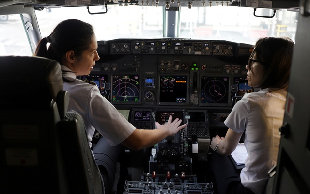 Captain Natalia Weiss and co-pilot Thays Goncalves of Brazilian Airline GOL prepare before taking off with a full female crew in the mark of International Women's Day, in Sao Paulo, Brazil, Mar 8 2020. REUTERS