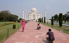A man gets his photograph taken in front of Taj Mahal after authorities reopened the monument to visitors, amidst the coronavirus disease (COVID-19) outbreak, in Agra, India, Sept 21, 2020. REUTERS