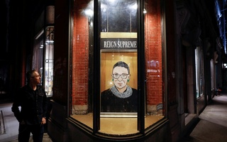 A person looks towards a painting in a storefront on Broadway of Associate Justice of the Supreme Court of the United States Ruth Bader Ginsburg who passed away in Manhattan, New York City, US, September 18, 2020. Reuters