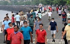 People stroll along the promenade at Marine Drive, amidst the coronavirus disease (COVID-19) outbreak, in Mumbai, India, Sept 22, 2020. REUTERS