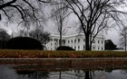 FILE PHOTO: The White House is reflected in a puddle in Washington, U.S., December 21, 2018. REUTERS