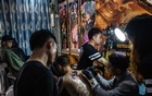 FILE -- A tattoo studio in Shenzhen, China, on Oct 24, 2018. Many younger Chinese have embraced tattooing, but others associate it with criminality. (Lam Yik Fei/The New York Times)