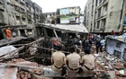 Police officers watch rescue operations after a three-storey building collapsed in Bhiwandi, on the outskirts of Mumbai, India, September, 21 2020. REUTERS