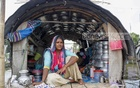 Snake-charming in the bazaar once was the main occupation of the Bede. Now the male river gypsies make a living from fishing while the women hawk clothes or utensils. Rupa Begum, a Bede woman, is no exception. Photo: Mahmud Zaman Ovi