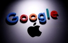 A 3D printed Google logo is placed on the Apple Macbook in this illustration taken Apr 12, 2020. REUTERS