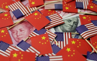 A US dollar banknote featuring American founding father Benjamin Franklin and a China's yuan banknote featuring late Chinese chairman Mao Zedong are seen among US and Chinese flags in this illustration picture taken May 20, 2019. Reuters