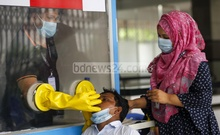 Rakib Hossain, a medical technologist at the COVID-19 test centre for overseas air passengers in Dhaka's DNCC Market, says it takes at least five hours to deliver the results. Photo: Mahmud Zaman Ovi