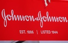 FILE PHOTO: The company logo for Johnson & Johnson is displayed to celebrate the 75th anniversary of the company's listing at the New York Stock Exchange (NYSE) in New York, US, September 17, 2019. REUTERS