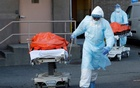 FILE PHOTO: Healthcare workers wheel the bodies of deceased people from the Wyckoff Heights Medical Center during the outbreak of the coronavirus disease (COVID-19) in the Brooklyn borough of New York City, New York, US, April 4, 2020. REUTERS