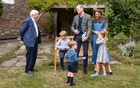 A handout photo released by Britain's Prince William and Cathrine, Duchess of Cambridge, Prince George (seated), Princess Charlotte and Prince Louis with David Attenborough after Prince William and David Attenborough attended an outdoor screening of the upcoming Attenborough's feature film, in the gardens of Kensington Palace, in London, Britain, Sept 24, 2020. REUTERS