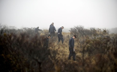 Police investigators search for human remains near Long Island's shoreline near Gilgo Beach on April 11, 2011. After a decade of little movement in a series of killings on Long Island, there is a new sense of urgency. Robert Stolarik/The New York Times