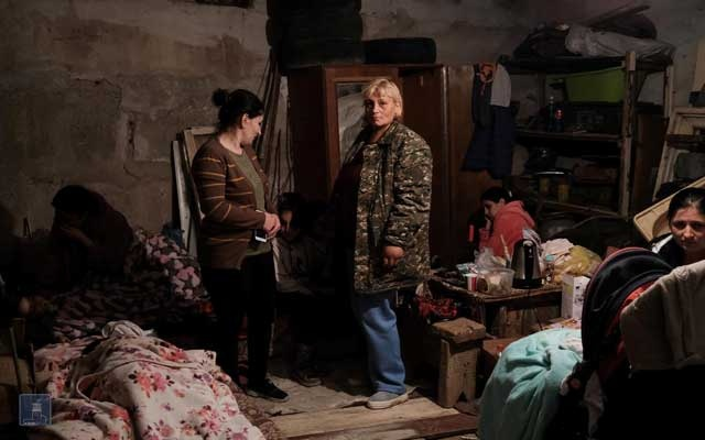 People are seen in a bomb shelter in Stepanakert, the capital of the breakaway Nagorno-Karabakh region, in this picture released September 28, 2020. Foreign Ministry of Armenia/Handout via REUTERS