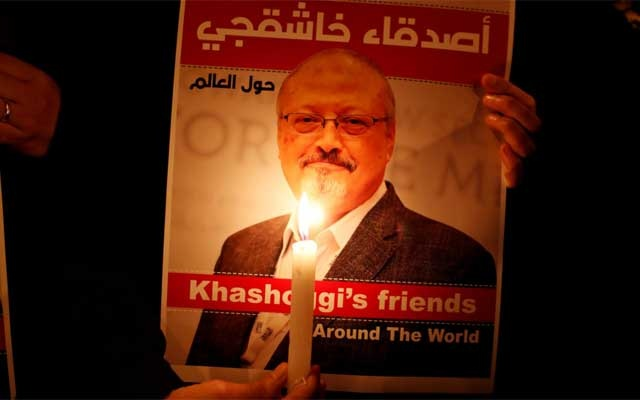 A demonstrator holds a poster with a picture of Saudi journalist Jamal Khashoggi outside the Saudi Arabia consulate in Istanbul, Turkey Oct 25, 2018. REUTERS
