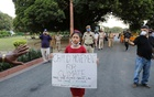 Licypriya Kangujam, 8, India's young climate activist, carrying a placard attends a protest demanding to pass a climate change law outside the parliament in New Delhi, India, September 23, 2020. Picture taken September 23, 2020. REUTERS