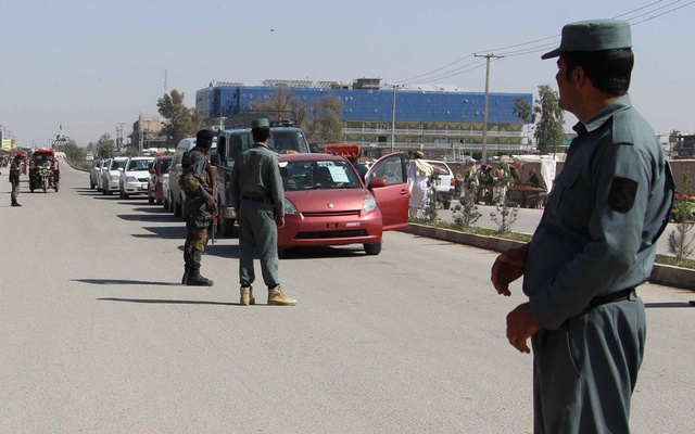 FILE PHOTO: Afghan policemen inspect vehicles at a checkpoint in Helmand province, Afghanistan, February 28, 2017. REUTERS/Abdul Malik/File Photo