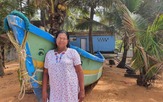 Fish vendor Jennet Cleetus poses for a picture outside her house in coastal village of Valiya Veli in Kerala, India, September 15, 2020. Thomson Reuters Foundation