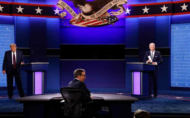 US President Donald Trump and Democratic presidential nominee Joe Biden stand on stage a the end of their first 2020 presidential campaign debate held on the campus of the Cleveland Clinic at Case Western Reserve University in Cleveland, Ohio, US, September 29, 2020. REUTERS