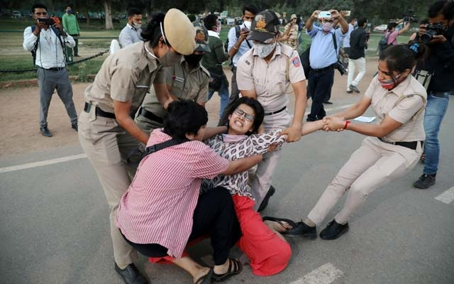 A demonstrator is detained by police during a protest after the death of a rape victim, on Rajpath near India Gate, in New Delhi, India, Sept 30, 2020. REUTERS