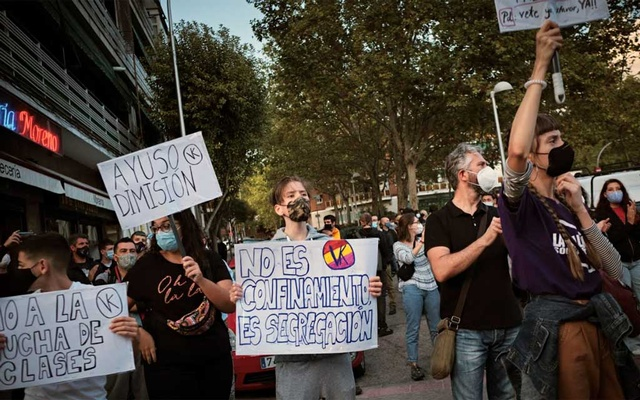 A protest on Sept 24, 2020, against coronavirus restrictions in Puente de Vallecas, one of the Madrid neighbourhoods under partial lockdown. New lockdown measures disproportionately affect the most economically vulnerable people in the capital region. Gianfranco Tripodo/The New York Times