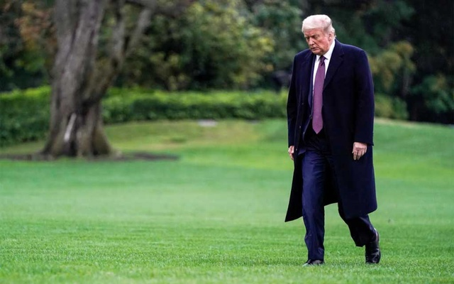 US President Donald Trump walks from Marine One as he returns from Bedminster, New Jersey, on the South Lawn of the White House in Washington, US, October 1, 2020. Reuters