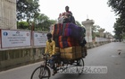 A retailer transporting blankets from Bangabazar wholesale market to Mohammadpur in Dhaka ahead of winter. Photo: Asif Mahmud Ove