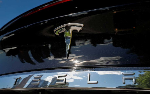 FILE PHOTO: The company logo is pictured on a Tesla Model X electric vehicle in this picture illustration taken in Moscow, Russia July 23, 2020. Picture taken July 23, 2020. REUTERS