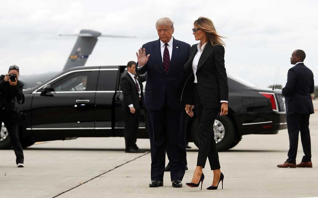 President Donald Trump waves to members of the news media as he and the first lady, Melania Trump, arrive in Cleveland for the first presidential debate on Tuesday, Sept. 29, 2020. Trump revealed early Friday morning, Oct. 2, that he and his wife had tested positive for coronavirus. (Tom Brenner/The New York Times)