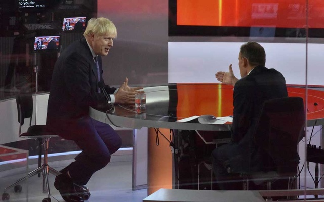 Britain's Prime Minister Boris Johnson appears on BBC TV's The Andrew Marr Show in London, Britain October 4, 2020. Picture taken through glass. Jeff Overs/BBC/Handout via REUTERS