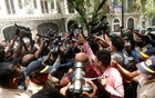 Media personnel surround Bollywood actor Rhea Chakraborty as she arrives at Narcotics Control Bureau (NCB) office for questioning, following the death of her boyfriend and actor Sushant Singh Rajput, in Mumbai, India, September 6, 2020. REUTERS
