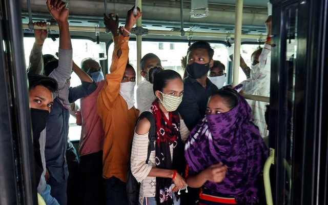 Commuters wearing protective masks travel in a passenger bus, amidst the coronavirus disease (COVID-19) outbreak, in Ahmedabad, India, September 11, 2020. Reuters