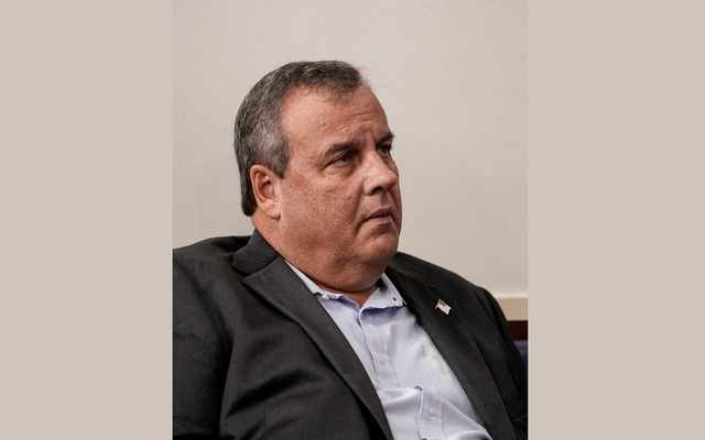 Chris Christie, former Governor of New Jersey, listens as US President Donald Trump speaks to reporters during a news conference inside the James S Brady Briefing Room at the White House September 27, 2020 in Washington, US .REUTERS