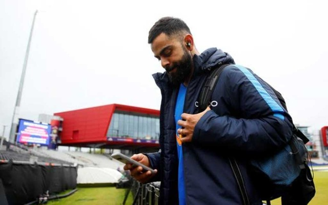 Cricket - ICC Cricket World Cup Semi-Final - India v New Zealand - Old Trafford, Manchester, Britain - July 9, 2019 India's Virat Kohli leaves after rain stopped play Action Images via Reuters/Jason Cairnduff