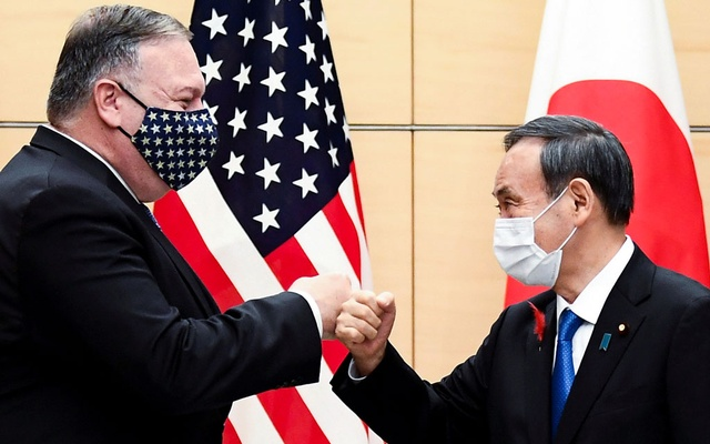 Japan's Prime Minister Yoshihide Suga and US Secretary of State Mike Pompeo greet prior to their meeting at the prime minister's office in Tokyo, Oct 6, 2020. REUTERS