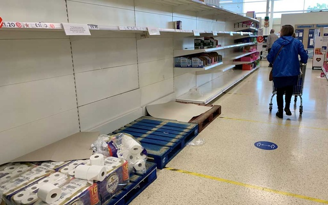 FILE PHOTO: A shopper pushes her trolley along an almost empty toilet paper aisle in a Tesco supermarket following the outbreak of the coronavirus disease (COVID-19) in Manchester, Britain, September 28, 2020. REUTERS