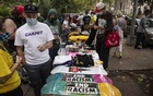 Shoppers browse items at the BLM Sidewalk Sale in Greenpoint, Brooklyn, where vendors sold new and used goods to raise money for those in need, Sept. 13, 2020. The New York Times