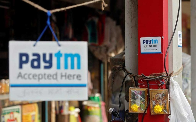 Advertisements of Paytm, a digital wallet company, are seen placed at stalls of roadside vegetable vendors in Mumbai, November 19, 2016. Reuters