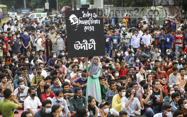 A protester holds a placard at a rally organised under the banner of