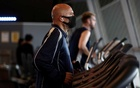 FILE PHOTO: People exercise at the gym of the London aquatics centre, following the reopening of swimming pools as the spread of the coronavirus disease (COVID-19) continues, in London, Britain, July 25, 2020. REUTERS
