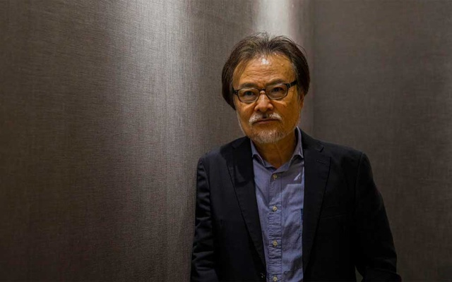 """Japanese film director Kiyoshi Kurosawa in Tokyo, Sept. 30, 2020. The latest movie, """"Wife of a Spy,"""" from Kurosawa — best known for horror movies depicting the dark undercurrents of life in modern Japan — is likely to cause a stir in the country, where wartime atrocities remain the subject of intense controversy and are seldom seen on the big screen. (Hiroko Masuike/The New York Times)"""