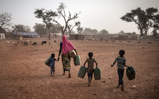 FILE -- Refugees at a camp for displaced people in Kongoussi, Burkina Faso, in March 2020. Presidential elections are scheduled soon in at least 10 African countries — many incumbents are changing constitutions and bending rules to ensure they stay in power. (Finbarr O'Reilly/The New York Times)
