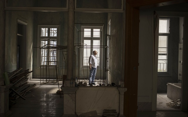 Fadlo Daghner, an architect, in his family's 19th-century villa, which he plans to restore, in Beirut, Sept 11, 2020. Many worry that a full recovery won't be possible, but residents of one of Beirut's most diverse and cosmopolitan areas are moving back in and trying to repair the damage from the August explosion. (Diego Ibarra Sanchez/The New York Times)