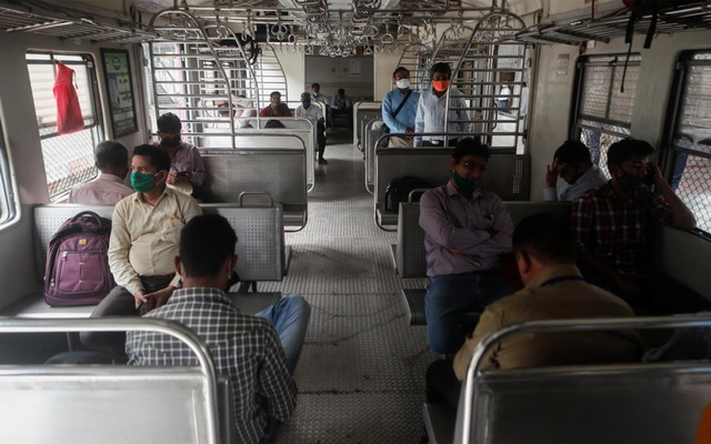 Commuters wait on a stalled suburban train during a power outage in Mumbai, India, Oct 12, 2020. REUTERS