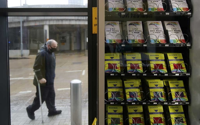 A 'Maskbox' vending machine is seen in an NCP carpark, following the outbreak of the coronavirus disease (COVID-19), in Manchester, Britain October 12, 2020. REUTERS